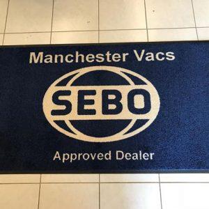 SEBO vacuum cleaner marketing carpet floor mat with printed logo for shampoo demonstration